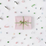 Pink gift box with ribbon and bow on white. Decorated with tinsel background. flat lat, top view Stock Photo