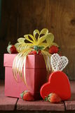 Pink gift box with ribbon and decorations Stock Image