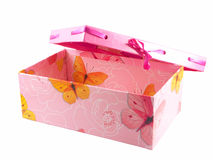 Pink gift box and ribbon isolated on white. Pink gift box with a yellow butterfly and ribbon isolated on white Royalty Free Stock Image