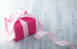 Pink Gift Box With Ribbon. On white painted wood background Stock Image