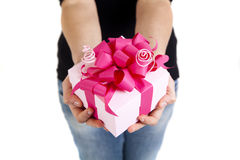 Pink gift box with ribbon. In woman hands Royalty Free Stock Photography