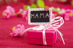 Pink gift box with signboard mama. Royalty Free Stock Photo