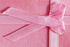 Pink gift box with tied ribbon Stock Photo
