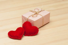 Pink gift box and two hearts Royalty Free Stock Images