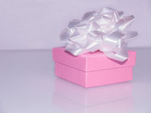 Pink gift box with white ribbon Stock Photography