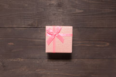 Pink gift box is on the wooden background with empty space Stock Photo