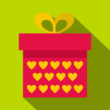 Pink gift box with yellow hearts icon, flat style Stock Image