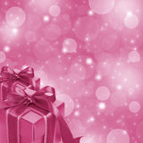 Pink gift boxes on glitter background Stock Images