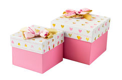 Two pink gift boxes with golden and pink bows Royalty Free Stock Images