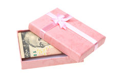 Pink gift with money anknotes on white Royalty Free Stock Image