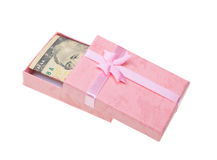 Pink gift with money banknotes on white Royalty Free Stock Images