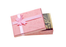 Pink gift with money banknotes on white Royalty Free Stock Photos