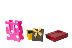 Pink gift packet, red giftbox and yellow brown gift box with ribbon isolated on white Royalty Free Stock Photography