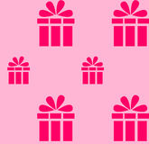 Pink gift pattern on a light pink background.  Royalty Free Stock Images