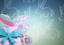 Pink gift and purple eggs against blue green easter pattern Stock Photos