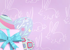 Pink gift and purple eggs against purple easter pattern Royalty Free Stock Images