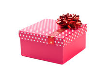 Pink gift with red ribbon. On white background Royalty Free Stock Images
