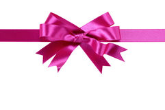 Pink gift ribbon bow straight horizontal isolated on white background Royalty Free Stock Images