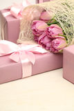Pink gift and tulip flowers Royalty Free Stock Photography