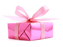 Pink gift wrapped present with rosy bow. Pink gift wrapped present with rosy satin ribbon bow isolated on white Stock Images