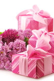 Pink gifts and chryzanthemiums Stock Image