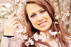 Pink girl. Beautiful polish girl in pink spring flowers Stock Image