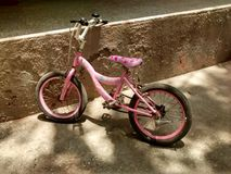 Girl bicycle. Girl transport pink cycle standing alone royalty free stock photography