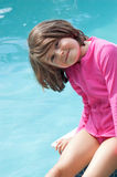 Pink girl at the blue pool stock photos