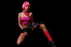 Pink girl with gun Stock Photography