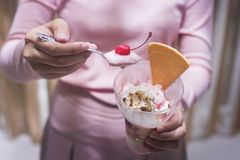 Pink girl Holding a cup of ice cream royalty free stock photo
