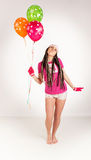 Pink girl. Pink balloon. stock photos