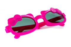 Pink girl sunglasses with ribbon and bow style isolated on white background royalty free stock photo