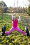 Pink Girl on Swing Stock Photo
