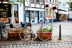 Pink girlish bike parked on the street Royalty Free Stock Image