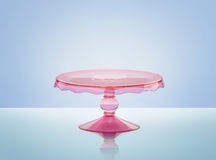 Pink glass cake stand. With reflection. 3D rendering Stock Image