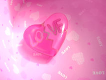Pink glass heart. Pink glass transparent heart in a pink gift box Stock Image