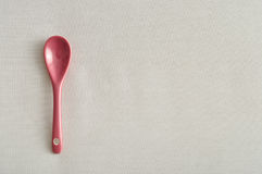 A pink glass teaspoon Stock Images