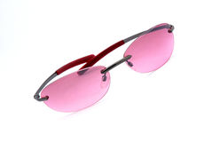 Pink glasses. Fashionable eyeglasses for sports people with pink colored glasses. Image isolated on white studio background royalty free stock photography