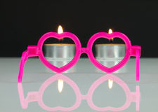 Pink glasses and candles. Royalty Free Stock Photos