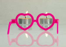 Pink glasses and candles. Royalty Free Stock Image