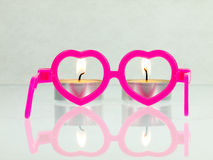 Pink glasses and candles. Stock Image