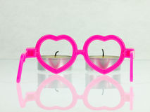 Pink glasses and candles. Royalty Free Stock Photo