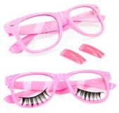 Pink glasses false eyelashes fake nails. White isolation of 2 pairs of pink glasses, 2 fake nails, and a false eyelashes Royalty Free Stock Photo
