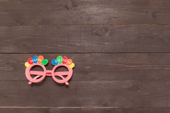Pink glasses with Happy Birthday massage is on the wooden backgr Royalty Free Stock Images