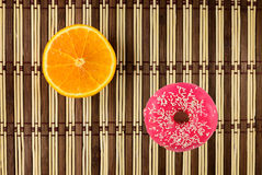 Pink glazed donut with orange Royalty Free Stock Images