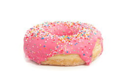 A pink glazed donut with speckles Stock Images