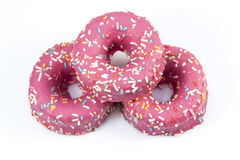 Pink glazed donuts with sprinkles Royalty Free Stock Photo