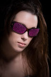 Pink glitter. Woman with sunglasses covered in pink glitter Stock Photo