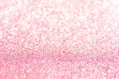 Pink glitter background with selective focus royalty free stock photography