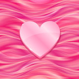 Pink glossy heart on silky background Royalty Free Stock Photography